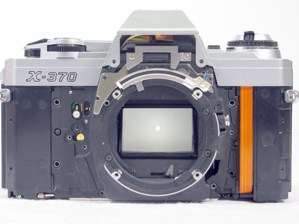 Image 3/3: Remove the black plastic lens holder.