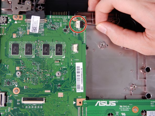 There are wires connecting the wireless card to the motherboard on the upper right half of the motherboard. Disconnect them.