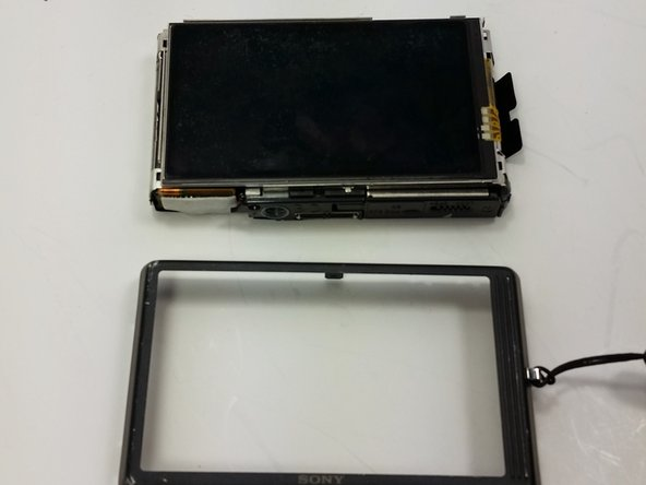 Remove the back cover so that the back cover is now completely separate from the body of the device.