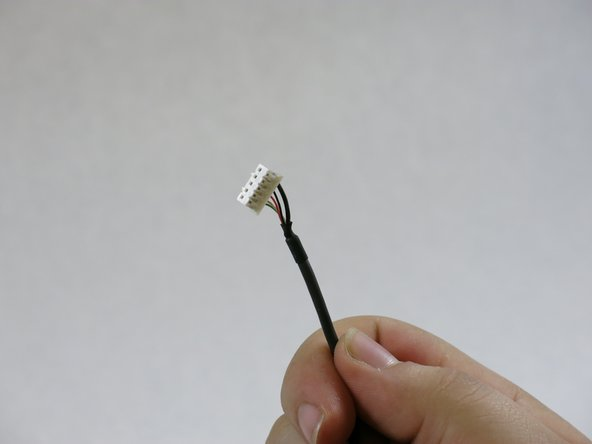 Take the replacement USB cable and connect it to the mainboard.