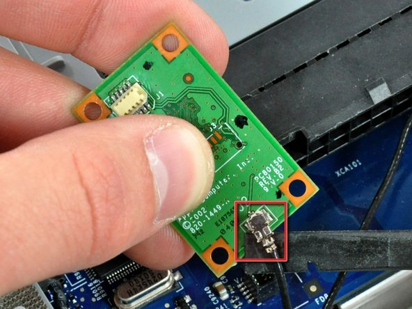 Image 2/2: Use the flat end of a spudger to pry the Bluetooth antenna connector up off the Bluetooth board.
