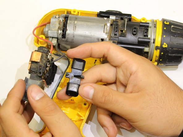 Image 2/2: '''Note:''' The side of the switch that has the two legs is placed facing down.