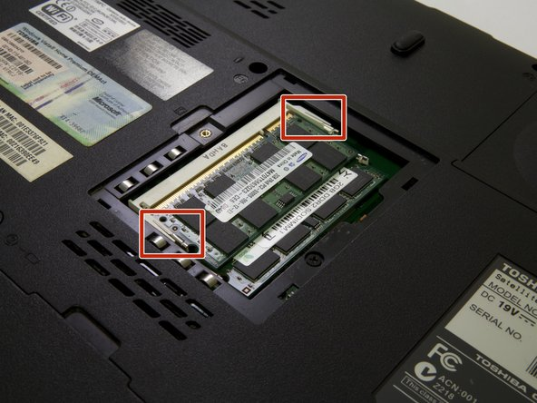 There are two metal holdings boxed in red is located at each side of the RAM chip (left and right).
