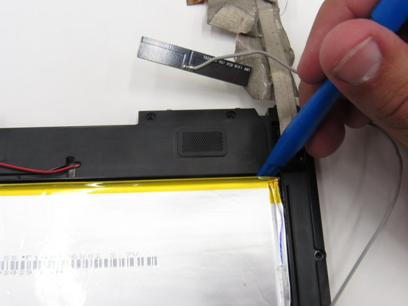 Use a plastic opening tool to pry the battery  from the circuit board by wedging it around the perimeter of the battery.