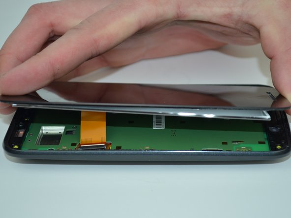 Avoid damaging the LCD screen connector while prying along the screen edges.  It is located on the left edge of the phone, across from the volume controls.