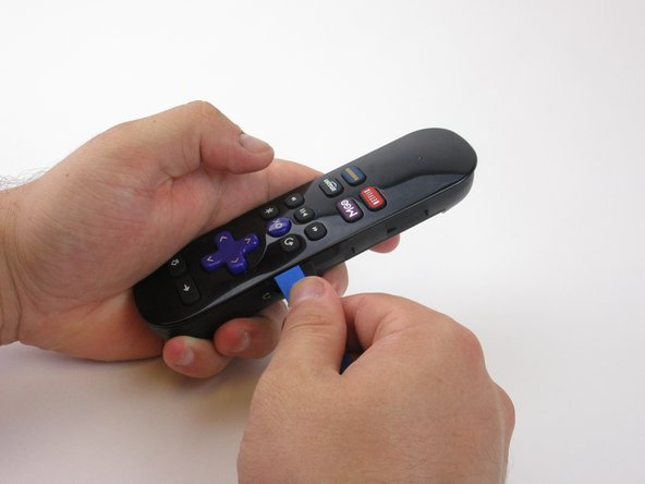Use the plastic opening tools to pry open the remote.
