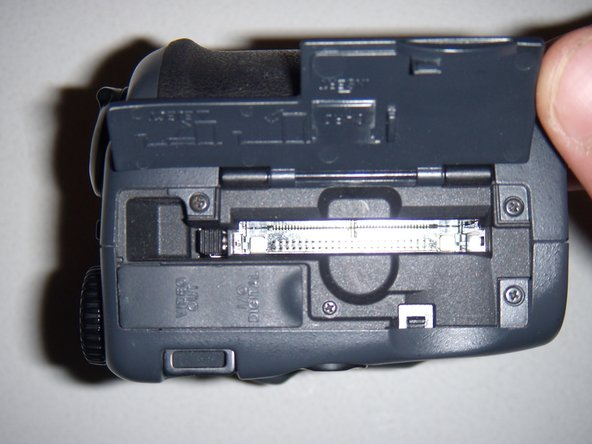 Now that the Memory card compartment is open, carefully remove the memory card.