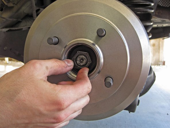 If you removed the wheel bearing with the brake drum, reinstall the rear hub nut.
