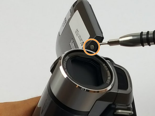 Using the Phillips #000, remove two more screws near the LCD panel swivel point.