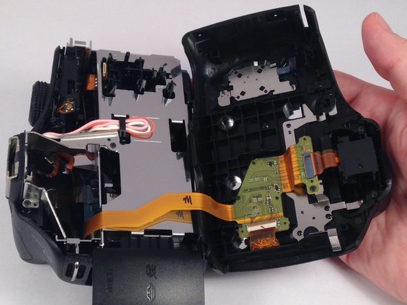 Remove the chassis by pulling the back cover away from the camera.