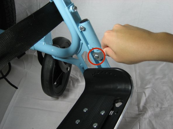 Remove the footrest by unscrewing the lower bolt, using the 10 mm wrench.