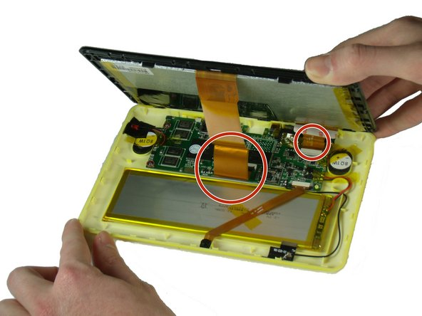 Lift the detached screen from the camera side until you can see the inside of the tablet.
