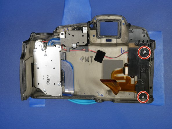 To remove the LCD hinge covers, remove the two screws circled on the right.