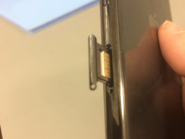 This step might need a bit of force to make the SIM card pop out.