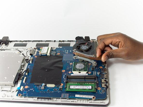 Remove the vent by lifting it away from the laptop.