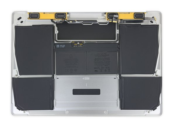 Your replacement battery may come affixed to a thick plastic top liner to help keep the individual cells in position as you install it. Don't remove this liner until after the battery is installed.