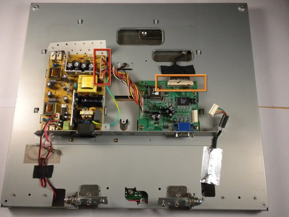 Image 1/3: Disconnect the multi-pin connector at the top of the board by firmly grasping the connector and pulling to the side.
