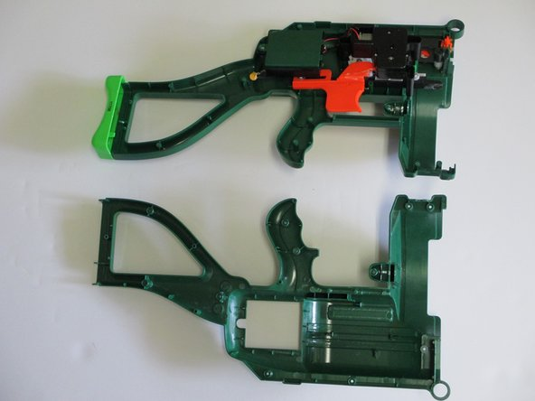 If this is your first time disassembling your gun, the stock will be glued to each half of the gun's body. To break off the stock from the frame of the gun, you will need to careful wiggle the two halves so that the glue will break apart. The plastic on the gun may break or warp slightly.