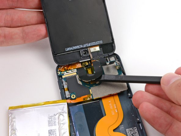 Use the flat end of a spudger to peel the display cable up from the logic board.
