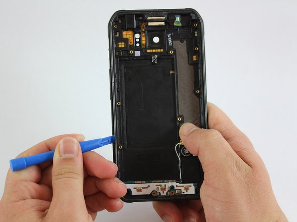 Once you see a large enough gap, insert a plastic tool between the frame and the plastic cover and slide it around the phone to separate both components.