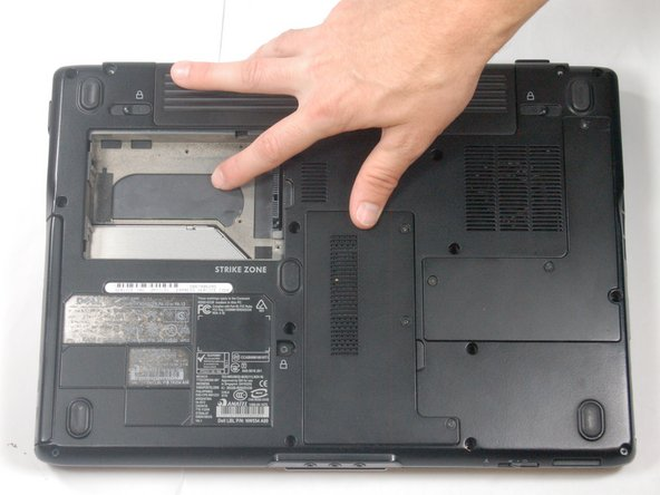 Remove the hard drive by pulling up on the black tab on the right side of the hard drive.