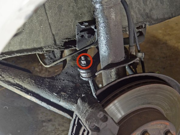 Use a socket wrench or impact gun to remove the 15 mm nut on the front sway bar endlink.