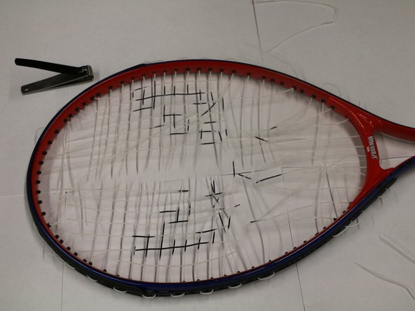 Finish cutting all of the strings off.