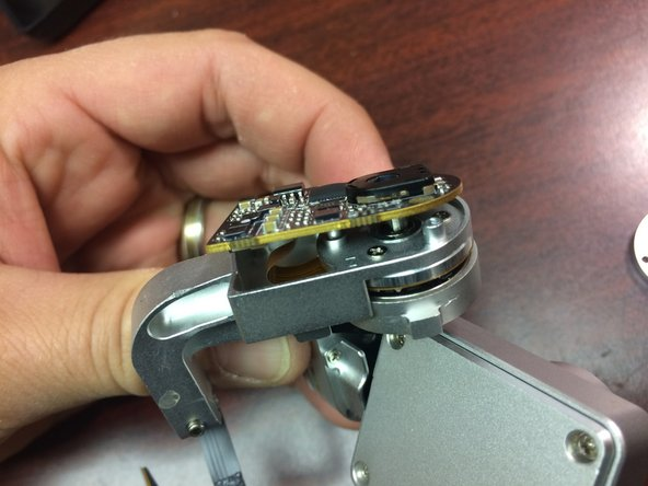 Next you need to lift the small circuit board up gently out of the yaw arm.
