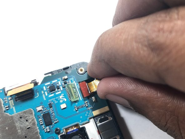 Once the camera is out of the housing, pull the camera from its connection on the logic board.