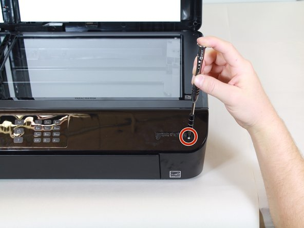 Remove the single 12mm-T10 screw securing the front panel to the printer body.