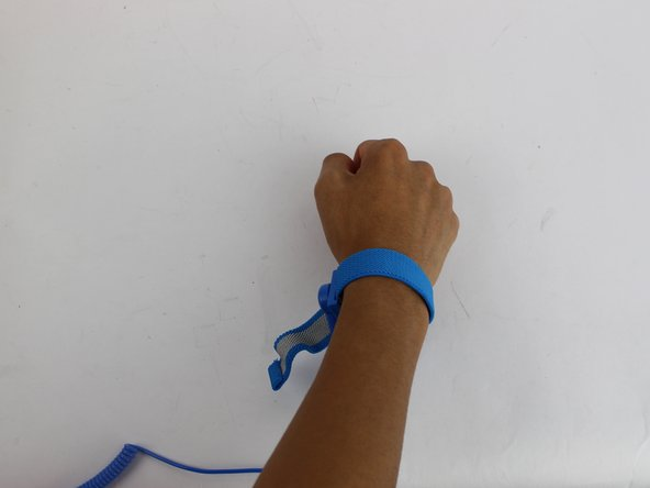 Put on the anti-static wrist trap and clip it to a large metal object.