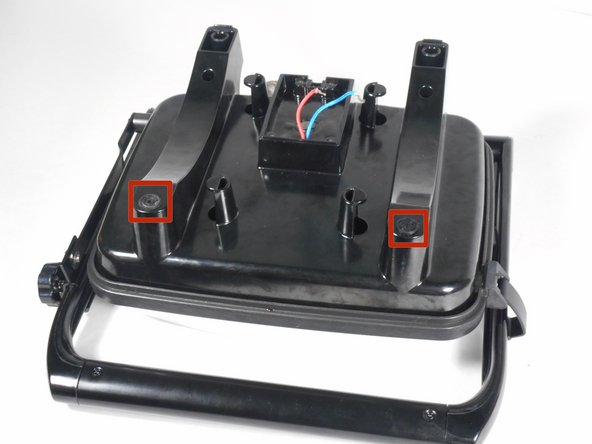 Remove the two rubber screw covers from the bottom of the Panini Press.