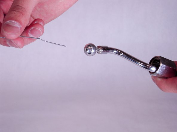 Using a thin tool or item, such as a paper clip, poke around through the holes on both ends of the wand to remove any foreign material.