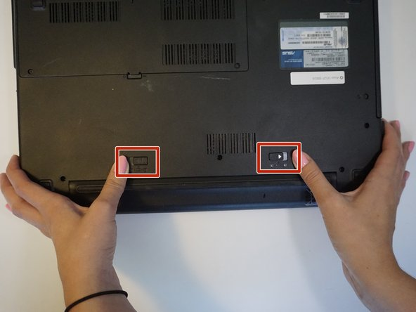 Image 1/2: Slide the right latch to unlock, then simultaneously slide the left latch outward while pulling the battery out.