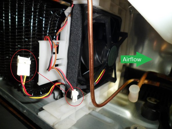 The direction of the fan, just slide it in, watch the wires and the gaspipe. Then put in the white part as shown on the second picture, the pipe lays in that foam. ja.