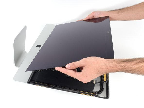 It may be necessary to slowly lift from one side to peel against the remaining adhesive.