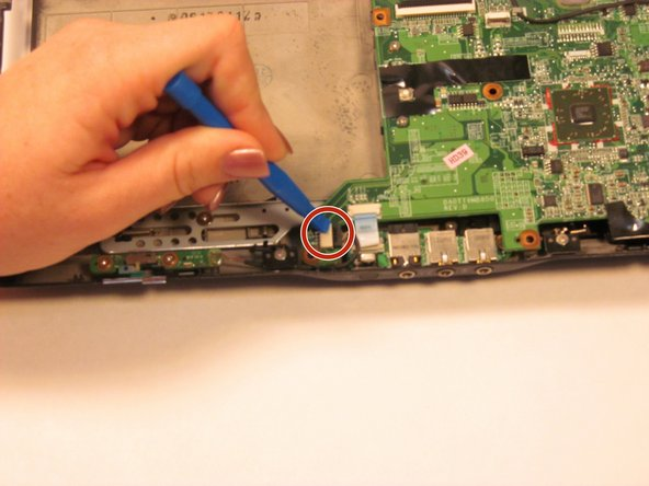 Image 2/2: Disconnect the wire using the plastic opening tool.