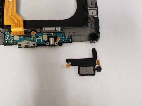 Remove the speaker and the vibration motor from the device.