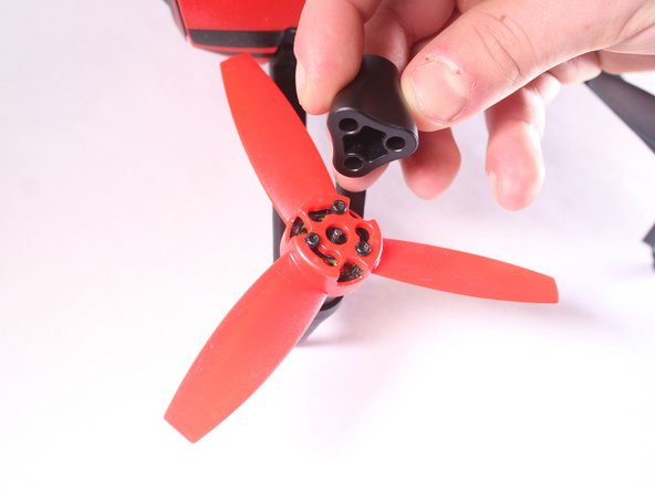 Using the propeller removal tool (included with the Parrot Bebop Drone), line up the holes with the protruding screws.