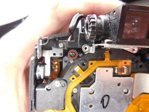 To get the lens assembly out, you need to remove four 6mm PH00 Philips screws