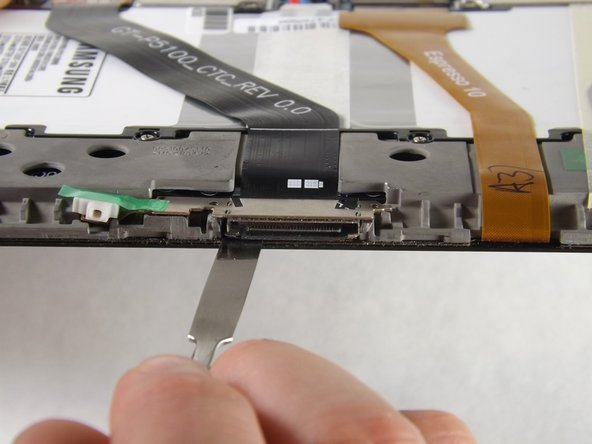 Image 1/3: Slide the flat end of the heavy-duty spudger under the charger port.