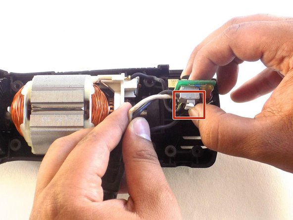 Image 1/2: Remove the power cord from the saw.