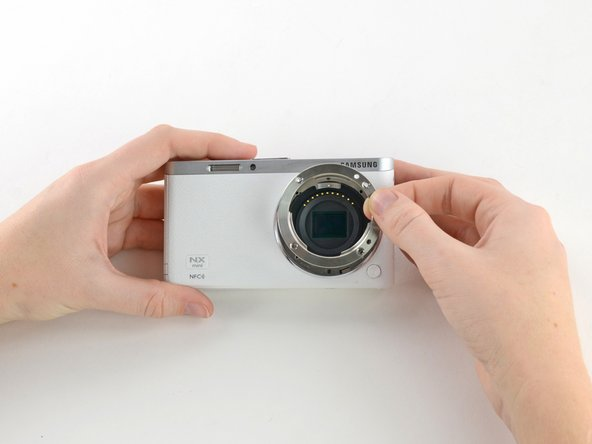 Remove the metal lens mount by hand or with tweezers.