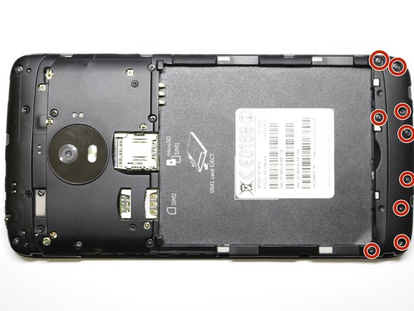 Remove nine (9) 4mm screws in the lower casing below the battery by screwing counter-clockwise with a Phillips #000.