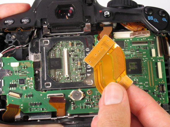 Use the plastic opening tool to remove the ribbon cable connecting the image sensor to the motherboard.