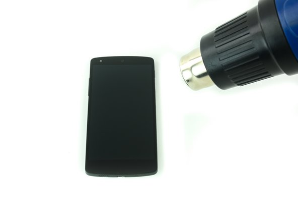 Use a heat gun or an iOpener to soften the adhesive along the edges of the screen.
