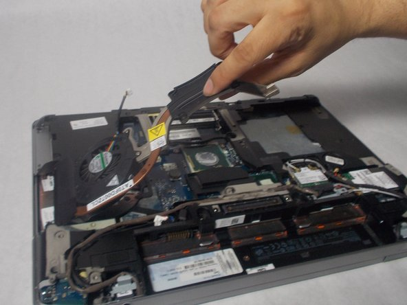 Lift the fan out of the laptop.