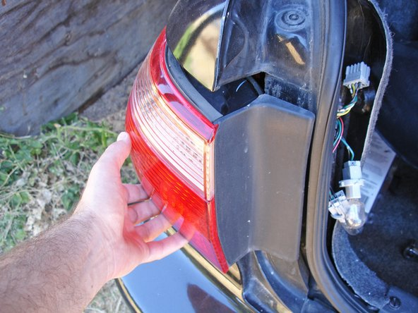 Remove the panel tail light assembly by pulling it straight away from the car.
