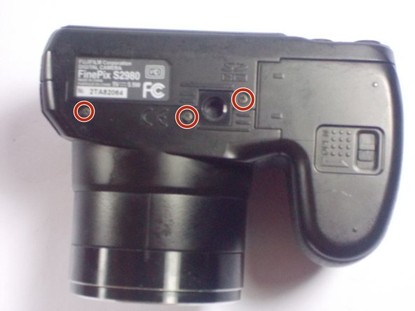 Use a PH0 screwdriver to remove four screws on the right side, three screws on the bottom, and four on the left side to take off the rear plate.
