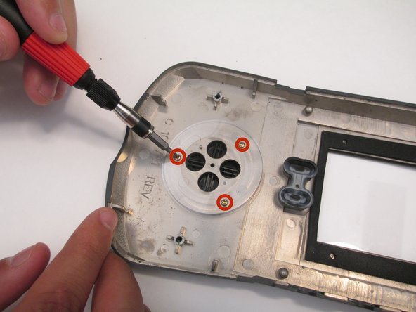 Image 1/2: The buttons should fall out once the screws have been removed.